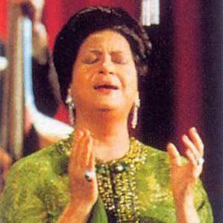 A photo for Umm Kulthum singing on a stage