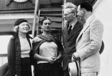Trotsky and his wife with Frida.