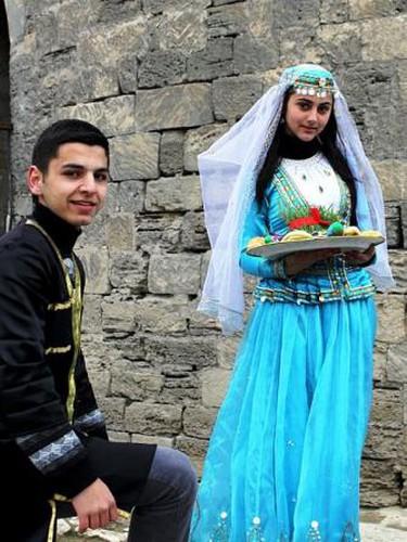 Celebrating Novruz Bayram wearing traditional costumes in Baku, Azerbaijan.