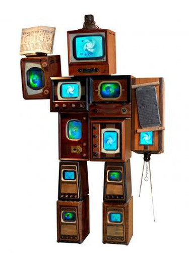 Nam June Paik, Li Tai Po, 1987. 10 antique wooden TV cabinets, 1 antique radio cabinet, antique Korean printing block, antique Korean book, 11 color TVs, 243.8 x 157.5 x 61 cm. Asia Society, New York: Gift of Mr. and Mrs. Harold and Ruth Newman, 2008.2. Photo credit: © 2007 John Bigelow Taylor Photography | Courtesy of Asia Society, New York