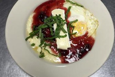 Stone Fox brunch special: gouda grits, cranberry compote, brie, and egg made to order.