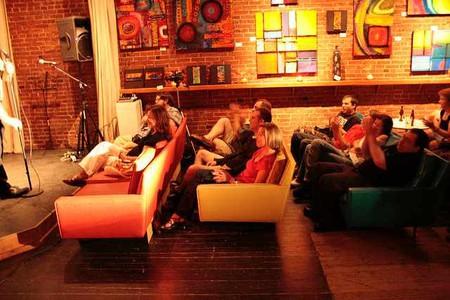 Patrons Enjoying Performance at Atomic Cowboy
