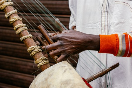 Playing the kora | © AND21 / Shutterstock