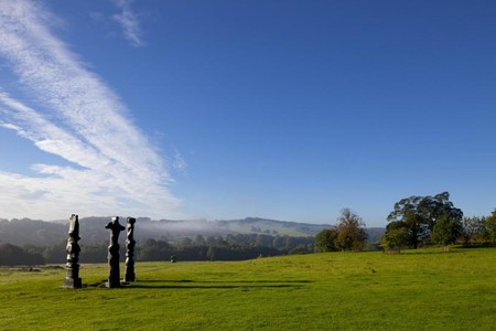 Henry Moore in the Country Park. Reproduced by Permission of The Henry Moore Foundation | © Jonty Wilde/Courtesy of YSP
