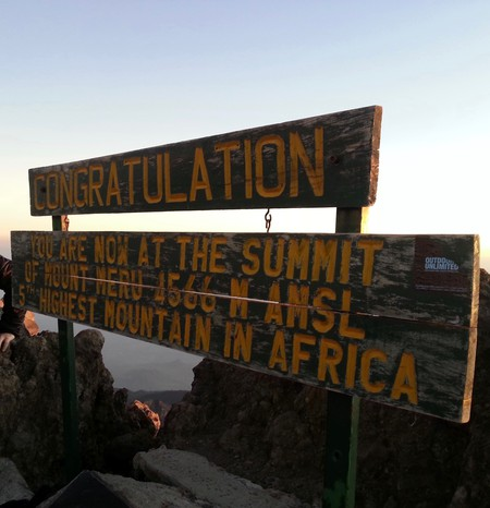 Reaching the Summit: Photo courtesy of Amani Chomolla