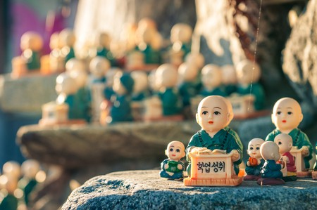 figurines scattered around the rocks of Haedong Yonggungsa Temple in Busan, South Korea. The figurines are meant to encourage academic achievement | © Vincent St. Thomas/Shutterstock