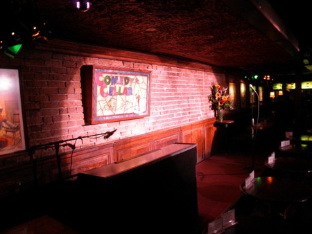 """The Comedy Cellar stage, one of the locations that the """"Louie"""" show is filmed."""