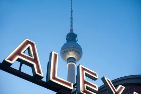 ther berlin fernsehturm tv tower and a neon sign at alexanderplatz