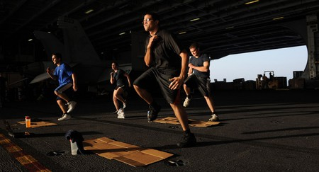 Sailors workout in hangar bay three aboard the Nimitz-class aircraft carrier USS John C. Stennis | ©  United States Navy/WikiCommons