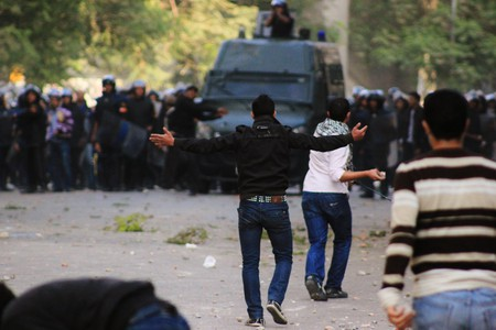 'Taking the rubber bullets with arms wide open', captured by Mostafa Sheshtawy in Egypt on November 19th, 2011. | Courtesy of the photographer.
