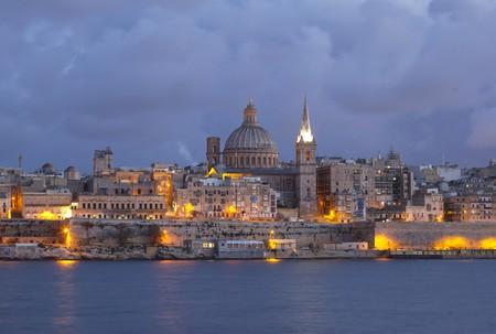 City of Valletta Malta at Sunset captured from Silema Bay   © Gaborturcsi/Shutterstock