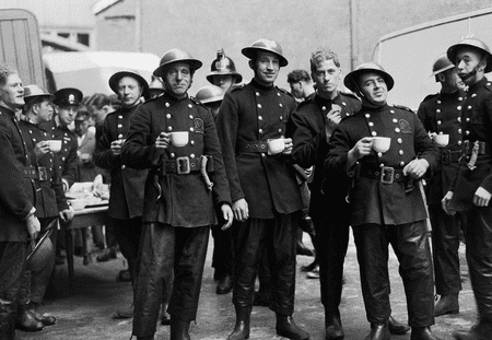 WWII-era London firemen and Auxiliary Fire Service firefighters take a tea break.
