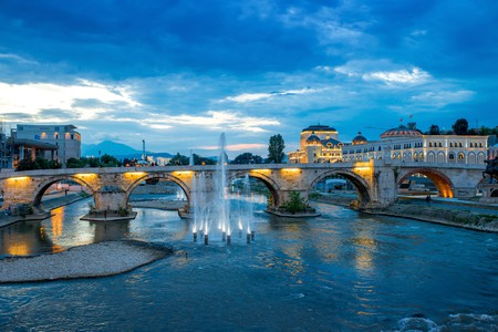 Stone bridge from Oko bridge in Skopje in the evening © RossHelen / Shutterstock