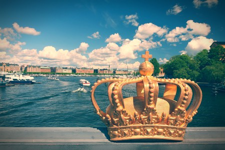 Stockholm, Sweden. Skeppsholmsbron (Skeppsholm Bridge) with its famous gilded crown and Strandvagen in background|© Tupungato/Shutterstock