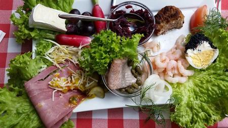 A smørrebrød plate including herring | ©  Max Handelsman / Flickr