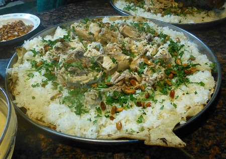 Jordanian Mansaf topped with herbs