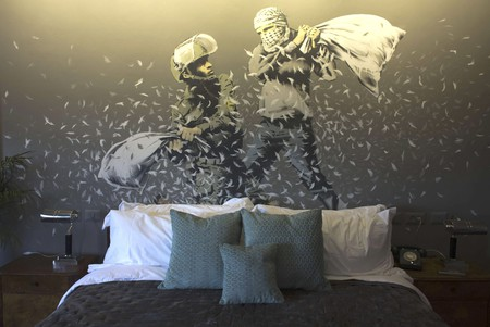 Stay at the Walled Off Hotel and you can rest your head under an authentic Banksy