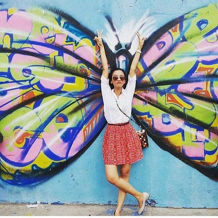 "A ""Fly"" Pose in Front of Mou Awudu's Street Graffiti 