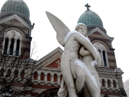 An angel statue in front of the French church at Binjiang Dao |   © Matthew Stinson