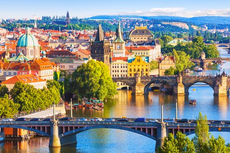 Scenic summer aerial view of the Old Town pier architecture and Charles Bridge over Vltava river in Prague, Czech Republic  | © Scanrail1/Shutterstock