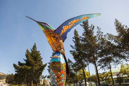 Hummingbird sculpture, painted by visual artists in the park colibries in the city in Quito. Ecuador   © postales/Shutterstock