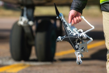 Hand holding crashed drone | Mark Agnor, Shutterstock