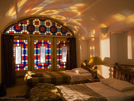 Sunlight streaming through stained glass windows lights this room in Yazd | © Julia Maudlin / Flickr