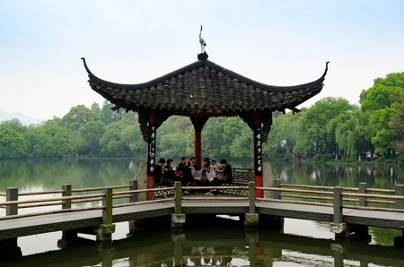 Relax in one of West Lake's pagodas I © xiquinhosilva/Flickr