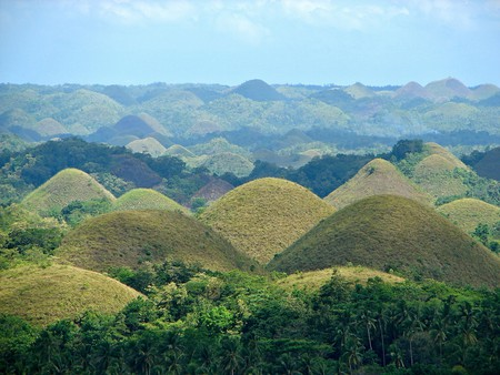 """<a href=""""https://commons.wikimedia.org/wiki/File:Chocolate_Hills_overview.JPG"""" target=""""_blank"""" rel=""""noopener noreferrer"""">Chocolate Hills, Bohol, the Phillipines 