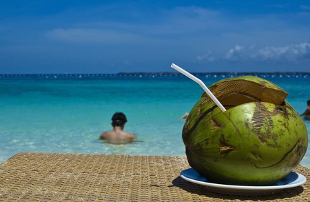 Drinking from a coconut | © Ian Go/ Flickr