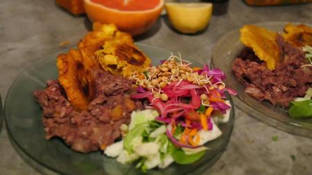 Refried beans, plantains and salad from the Latin menu at Jueves A La Mesa | Courtesy of Jueves A La Mesa