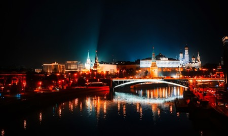 The illuminated Kremlin rises above the Moskva River in Moscow