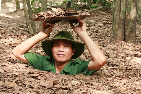 Crawling out of a tiny entrance at Cu Chi Tunnels | © rubber bullets/Flickr