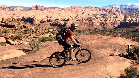 Cyclist riding in Moab, UT   © trailsource.com / Flickr