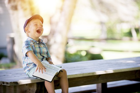 """<a href = """"https://www.pexels.com/photo/laughing-boy-sitting-on-table-during-daytime-160191/""""> Laughing Boy 