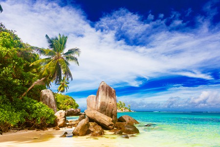 vacation at perfect tropical sandy beach. Fairytale beach, Mahe, Seychelles   © Elena Rudakova / Shutterstock