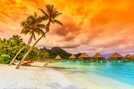Bora Bora, French Polynesia. Otemanu mountain, beach and palm trees | © emperorcosar / Shutterstock
