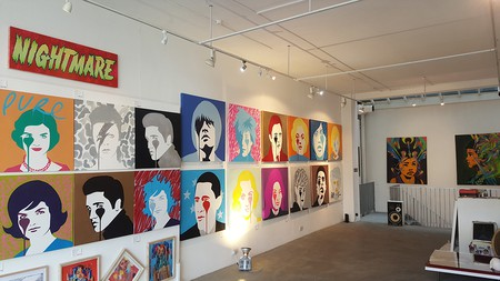 Pure Evil's work lines the walls in the gallery