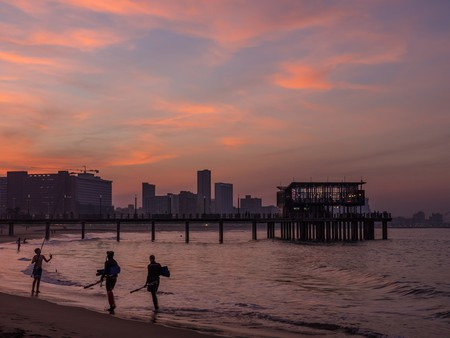 Take a stroll along the beach at sunset | © South African Tourism/Flickr