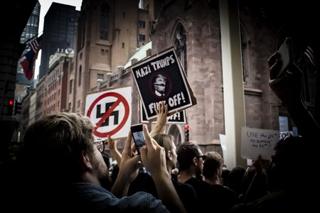 Anti-Nazi signs at a protest at Trump Tower, New York   © Amanda Suarez/ Culture Trip