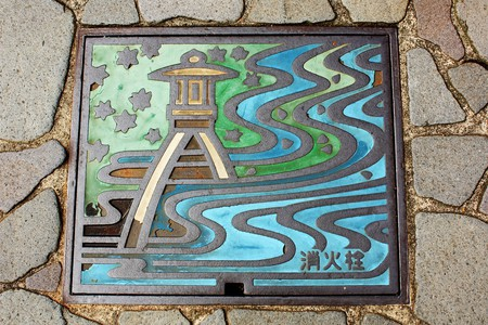 Full-color manhole cover in Kanazawa, Japan    © Andrea Schaffer / Flickr