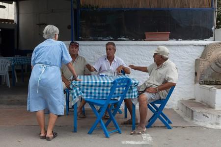 Santorini locals sitting down for lunch | © StockStudio/Shutterstock
