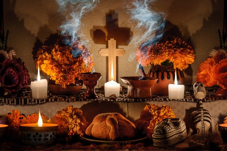 Traditional day of the dead altar with pan de muerto and candles