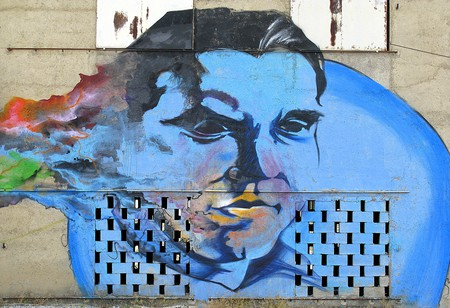 A spray-paint mural of Federico Garcia Lorca on a barn in his birthplace of Granada; Spencer Means/flickr