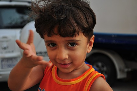 Gestures learned from a young age | © Jayme del Rosario/Flickr