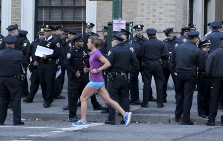 A runner goes past NYPD officers during the 2016 NYC Marathon | © Seth Wenig/AP/REX/Shutterstock
