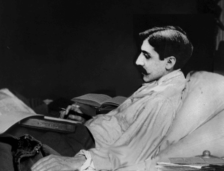 Marcel Proust working in bed, early 20th-century. Photographer unknown.