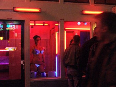 Woman in a window in red light district | © Nina A. J. G. / Flickr