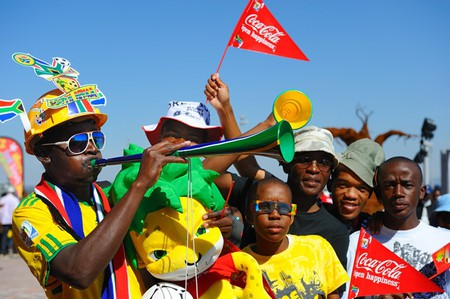 Soccer fan blows a Vuvuzela | © Coca-Cola South Africa / Flickr