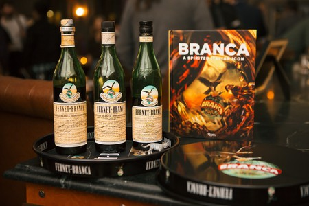 Bottles of Fernet-Branca along with a copy of the brand's new book | Courtesy of Fernet-Branca